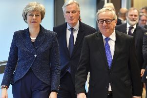European Commission President Jean-Claude Juncker, British Prime Minister Theresa May and European Union chief Brexit negotiator Michel Barnier. Picture: AP Photo/Geert Vanden Wijngaert