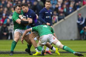 Ireland's Can Healy (left) and James Ryan tackle Scotland's Sean Maitland. Pic: SNS/Bill Murray