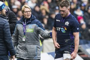 Scotland's Stuart Hogg is forced off early on with an injury. Pic: SNS/Paul Devlin