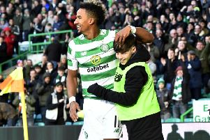 Scott Sinclair celebrates his opening goal with a Celtic Park ballboy. Picture: SNS Group