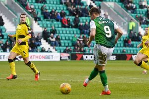 Marc McNulty  fires in Hibs' third goal against Raith Rovers, after a tumultuous week for his family. Picture: SNS.