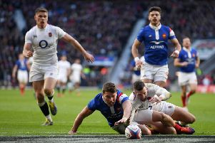 England's hat-trick hero Jonny May battles Antoine Dupont for possesion during the home side's thumping victory. Picture: Getty.