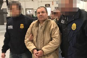 """Joaquin Guzman Loera aka """"El Chapo"""" Guzman (C) escorted in Ciudad Juarez by the Mexican police as he is extradited to the United States. Picture: Getty"""