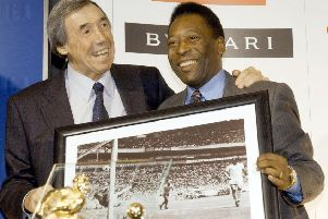 Gordon Banks will always be remembered for his save against Pele. The pair are pictured here in 2004 with a framed picture of the famous moment. Picture: PA.