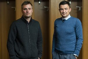 Robbie Stockdale, left, and new Hibs manager Paul Heckinbottom check in at Easter Road with a mission to produce a 'team that will give their all, work hard and be attack-minded'. SNS