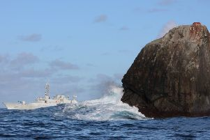 The island of Rockall with Irish naval vessel HE Roisin. PIC: Creative Commons/Irish Defence Forces.