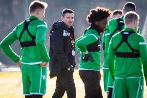 New 'Hibs head coach Paul Heckingbottom observes the players at training. Picture: Ross Parker/SNS