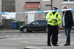 Cops raced to the scene on Dykemuir Street in the city's Springburn area after the alarm was raised around 11.15am on Saturday morning. Picture: John Devlin