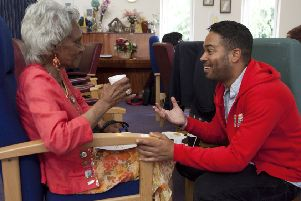 Ambassador for the People's Postcode Lottery, Danyl Johnson, visits users of the Carers Trust service. Photograph: Getty