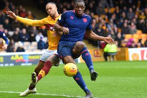 Motherwell's Charles Dunne battles for possession with Uche Ikpeazu of Hearts. Picture: SNS Group