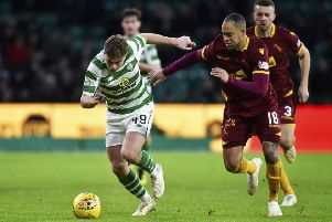 Celtic's James Forrest comes up against Motherwell's Charles Dunne. Picture: SNS/Rob Casey