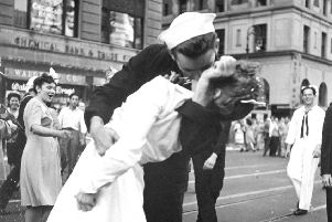 A sailor and nurse embrace in New York's Times Square. (AP Photo/United States Navy, Victor Jorgensen)