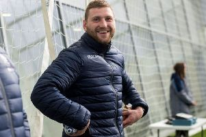 A smiling Finn Russell at Scotland's Oriam training base. Picture: Bill Murray/SNS