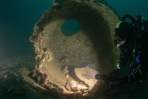 A driver examines remains of the SMS Derfflinger which was known as the Iron Dog by the British Navy given its resillience. PIC: Bob Anderson.