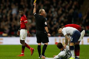 Could we see English referee Mike Dean and his legendary 'no-look' yellow cards in the Scottish Premiership? Picture: Getty Images