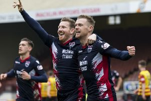 Ross County's Billy McKay celebrates his late goal with Michael Gardyne. Pic: SNS/Bruce White