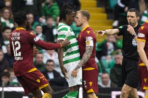 Celtic defender Dedryck Boyata and Motherwell's Richard Tait exchange words after the away side pull a goal back. Picture: SNS