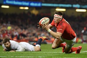 England's Elliot Daly can only watch on in anguish as Josh Adams touches down for Wales' match-clinching second try.''Picture: Dan Mullan/Getty Images