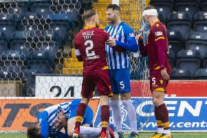 Kilmarnock's Stephen O'Donnell collapses to the ground as Richard Tait and Kirk Broadfoot exchange words. Pic: SNS/Alan Harvey