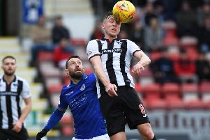 Dunfermline's Tom Beadling challenges Stephen Dobbie. Photograph: Ross MacDonald/SNS Group