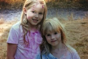 This photo provided by the Humboldt County Sheriff's Office shows Leia Carrico, 8, left, and her sister Caroline Carrico, 5, as they seeked the public's help in locating them. (Humboldt County Sheriff's Office via AP)