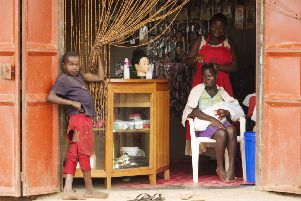Open for business ' Lydia is now the proud owner of a new hair salon in Lugazi, central Uganda