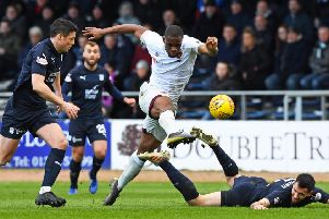 Hearts' Uche Ikpeazu powers his way through the Dundee defence during Saturday's 1-0 victory. Picture: SNS.