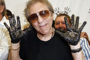 Hal Blaine holds up hands covered in wet cement following an induction ceremony at Hollywood's RockWalk in Los Angeles in 2008. Picture: AP