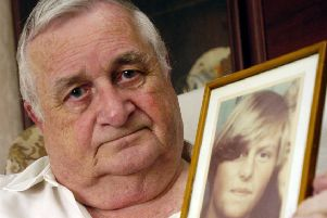Morain Scott with a photograph of his murdered daughter Helen Scott (Picture: Danny Lawson)