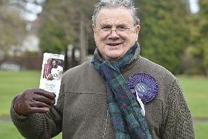Peter Murray with his ticket for Twickenham, where he hopes Scotland can emulate the heroics of the teams of, from the top, 1971, 1983 and 1989