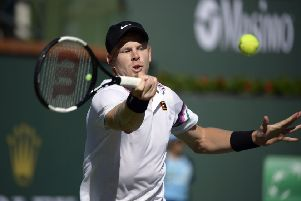 Kyle Edmund hits a forehand to Roger Federer at the Indian Wells Masters in California. Picture: AP