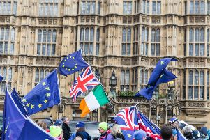 Pro-Brexit and anti-Brexit protesters continue to gather in Westminster as they await the vote on whether Brexit will be delayed. Picture: Getty