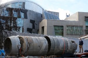 Owain Hughes views the Black Arrow rocket'outside the Scottish Parliament, Edinburgh. Picture: Andrew Milligan/PA Wire