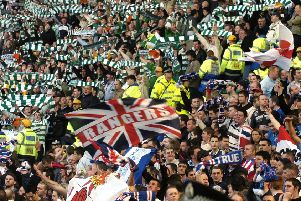 Celtic and Rangers fans during a derby match. Jim Duffy has no plans to join them (Picture: Ian Rutherford)