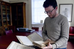 Curator Robert Betteridge holds Poems Chiefly In The Scottish Dialect by Robert Burns. Picture: Lisa Ferguson