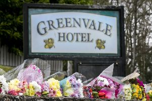 Floral tributes outside The Greenvale Hotel in Cookstown, Co. Tyrone, in Northern Ireland. Picture: Liam McBurney/PA Wire