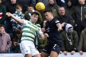 Kieran Tierney goes head to head with John O'Sullivan of Dundee during Sunday's Ladbrokes Premiership game at Dens Park. Picture: Rob Casey/SNS
