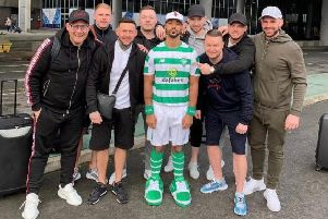 Shay Logan uploaded a picture of him wearing a full Celtic kit