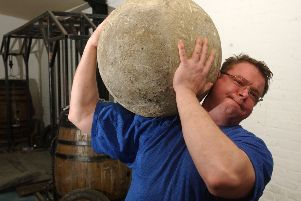 A big stone was an early fitness 'gadget' that may actually be more effective than some modern ones. Just make sure you don't drop it (Picture: Cate Gillon)