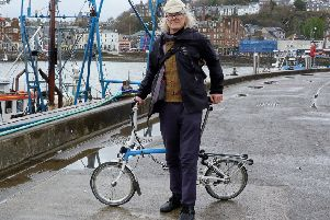 Millionaire Roc Sandford in Oban en route to Gometra ' but forget luxury cars and helicopters, he uses public transport and a bike. Picture: Moira Kerr
