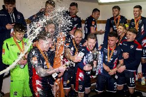 Ross County celebrate in the dressing room at full-time. Picture: SNS