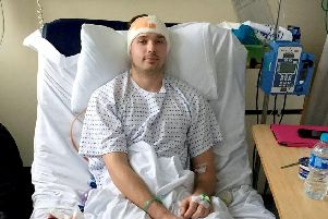 Craig Telfer, 27, in hospital following his operation at Glasgow's Queen Elizabeth University Hospital. Picture: SWNS