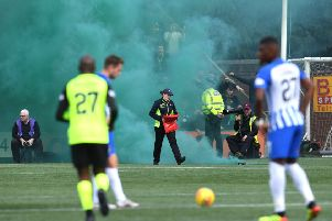 Kilmarnock take on Celtic as stewards deal with smoke bombs. UEFA fines clubs in European competitions through strict liability if their fans use pyrotechnics. Picture: SNS Group