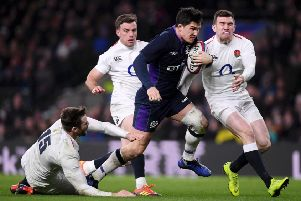 Sam Johnson evades the clutches of Elliot Daly, George Ford and Ben Spencer as he crosses to score Scotland's sixth try against England at Twickenham. Picture: Laurence Griffiths/Getty Images