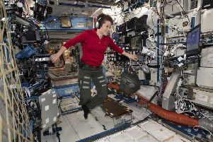 Flight Engineer Anne McClain, seen in International Space Station, was supposed to do a spacewalk yesterday but her suit was too large (Picture: Nasa via AP)