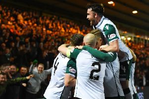 Paul Hanlon celebrates his opener with his Hibs team mates. Picture: SNS Group