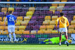 Motherwell goalkeeper Mark Gillespie saves Liam Craig's first-half penalty. Picture: SNS