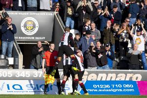 St Mirren' players celebrate Brad Lyons' goal in front of the home support. Picture: SNS