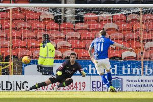Stephen Dobbie sends Benjamin Siegrist in the United goal the wrong way from the penalty spot. Photograph: Kenny Smith/SNS