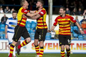 Steven Anderson, left, wheels away to celebrate after scoring for Partick Thistle. Picture: SNS